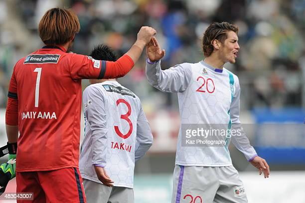 Noriyoshi Sakai of Avispa Fukuoka celebrates their win with his team mate Ryuichi Kamiyama of Avispa Fukuoka action during the J League second...