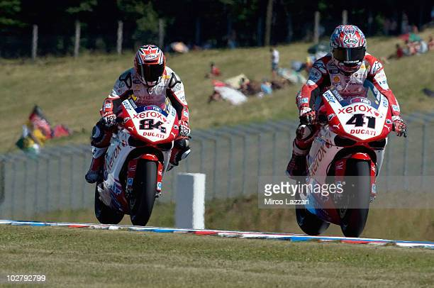 Noriyuki Haga of Japan and Ducati Xerox Team leads Michel Fabrizio of Italy and Ducati Xerox Team during the qualifying practice of round nine of...