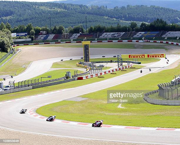 Noriyuki Haga of Japan and Ducati Xerox Team with Carlos Checa of Spain and Althea Racing and Jonathan Rea of England and HANNspree Ten Kate Honda in...