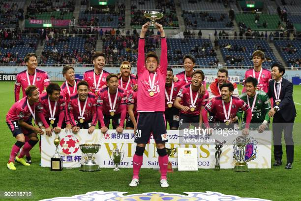 Noriyuki Sakemoto of Cerezo Osaka lifts the trophy after the 97th All Japan Football Championship final between Cerezo Osaka and Yokohama FMarinos at...