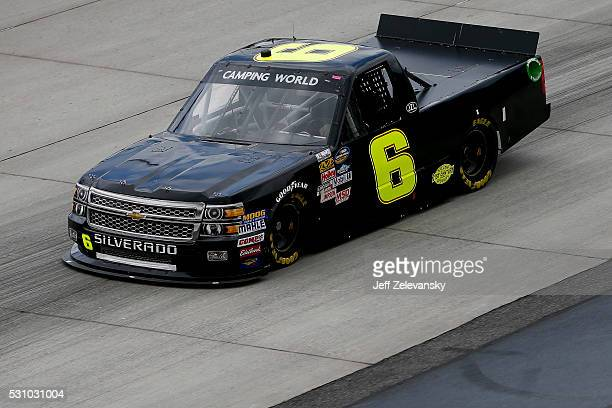 Norm Benning driver of the Chevrolet practices for the NASCAR Camping World Truck Series at Dover International Speedway on May 12 2016 in Dover...