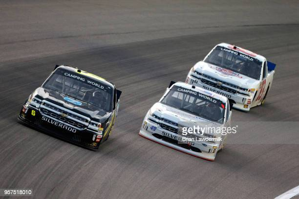 Norm Benning driver of the Zomongo Chevrolet leads Wendell Chavous driver of the SobrietyNationorg Chevrolet and Kevin Donahue driver of the Mittler...