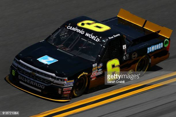 Norm Benning driver of the Zomongo/HH Transport Chevrolet practices for the NASCAR Camping World Truck Series NextEra Energy Resources 250 at Daytona...