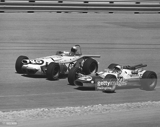Norm Brown races with Mario Andretti during practice for the Jimmy Bryan Memorial 150 USAC Indy Car race at Phoenix International Raceway Brown...