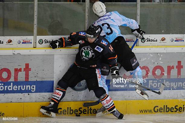 Norm Milley of Wolfsburg and Paul Manning of Hamburg in action during the DEL match between Grizzly Adams Wolfsburg and Hamburg Freezers at the...