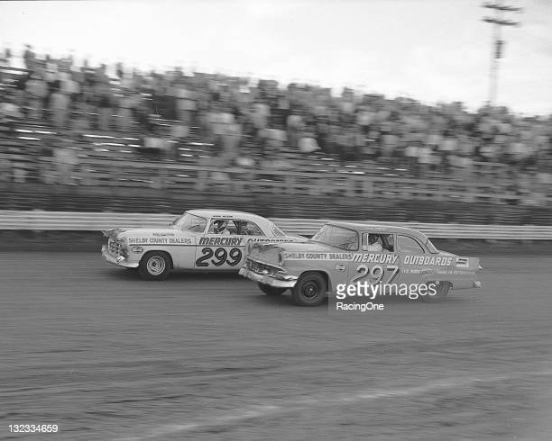 Norm Nelson in a Chrysler races with the Ford of Speedy Thompson during the NASCAR Cup race at MemphisArkansas Speedway Thompson went on to win the...