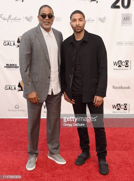 Norm Nixon and Norm Nixon Jr arrive at the WACO Theater Center's 3rd Annual Wearable Art Gala at The Barker Hangar at Santa Monica Airport on June 1...