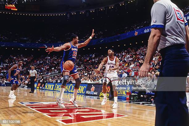 Norm Nixon of the East passes against Maurice Lucas of the West Legends team during the Schick Legends Classic at 1992 AllStar Weekend on February 8...