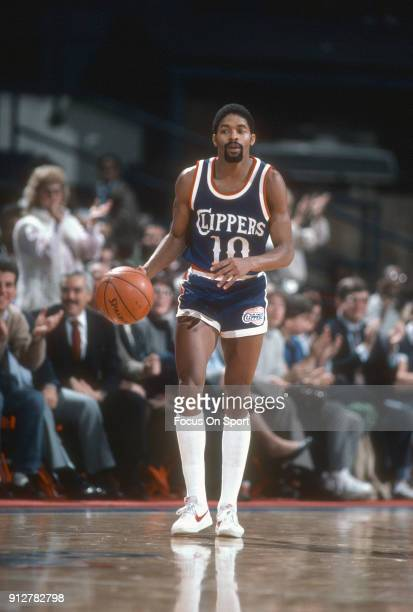 Norm Nixon of the Los Angeles Clippers dribbles the ball up court against the Washington Bullets during an NBA basketball game circa 1984 at the...