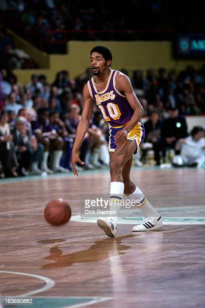 Norm Nixon of the Los Angeles Lakers dribbles the ball against the Boston Celtics circa 1979 at the Boston Garden in Boston Massachussets NOTE TO...