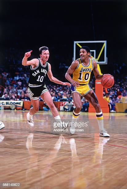 Norm Nixon of the Los Angeles Lakers dribbles the ball against the San Antonio Spurs during a game circa 1986 at The Forum in Los Angeles California...