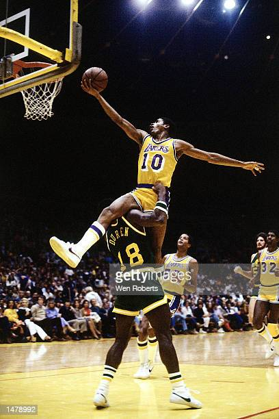 Norm Nixon of the Los Angeles Lakers drives over the top of John Duren of the Indiana Pacers in Los Angeles California NOTE TO USER User expressly...