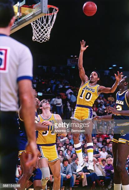 Norm Nixon of the Los Angeles Lakers shoots the ball against the Indiana Pacers during a game circa 1988 at The Forum in Los Angeles California NOTE...