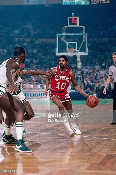 Norm Nixon of the San Diego Clippers moves the ball up court against the Boston Celtics during a game played in 1984 at the Boston Garden in Boston...