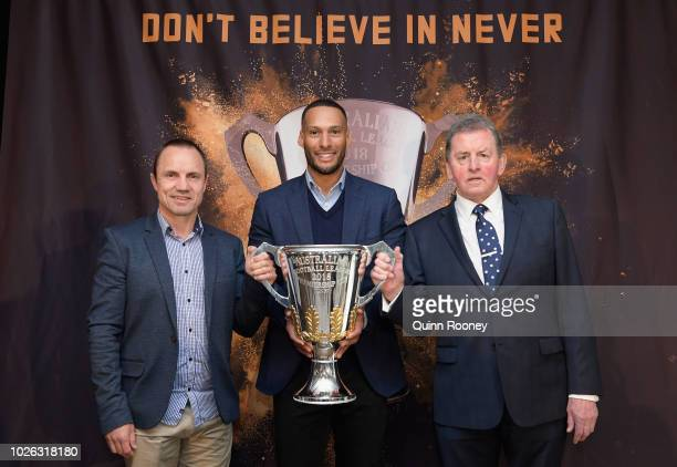 Norm Smith Medal presenter Shaun Hart Premiership Cup Ambassador Josh Gibson and Jock McHale Medal presenter Denis Pagan pose for a photo during the...