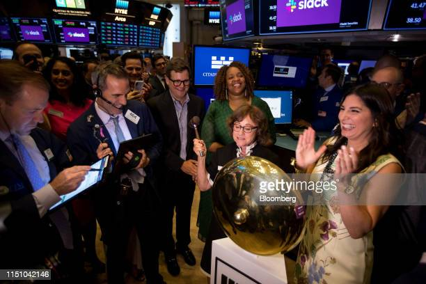 Norma Butterfield, mother of Slack Technologies Inc. CEO Stewart Butterfield, center, rings a ceremonial bell during the company's initial public...