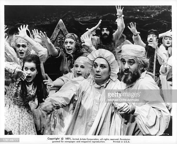 Norma Crane and Topal are reaching outward in a scene from the film 'Fiddler On The Roof' 1971