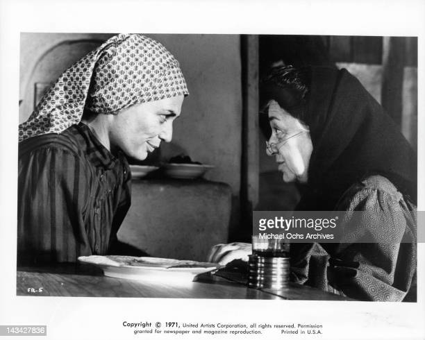 Norma Crane serves tea to Molly Picon in a scene from the film 'Fiddler On The Roof' 1971