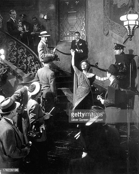 Norma Desmond played by American actress Gloria Swanson greets crime reporters thinking them part of a film cast in the final scene of 'Sunset...