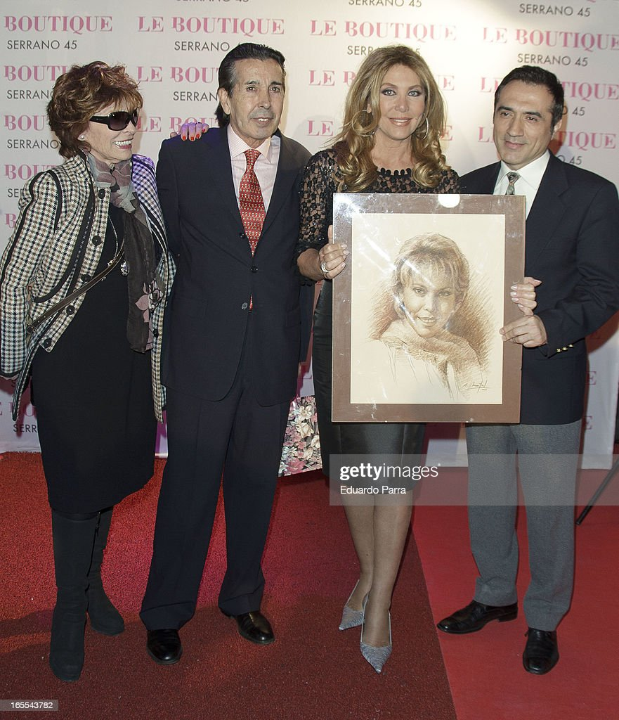 Norma Duval and friends pose with a picture of his sister Carla at the photocall for her birthday party at Le Boutique disco on April 4, 2013 in Madrid, Spain.