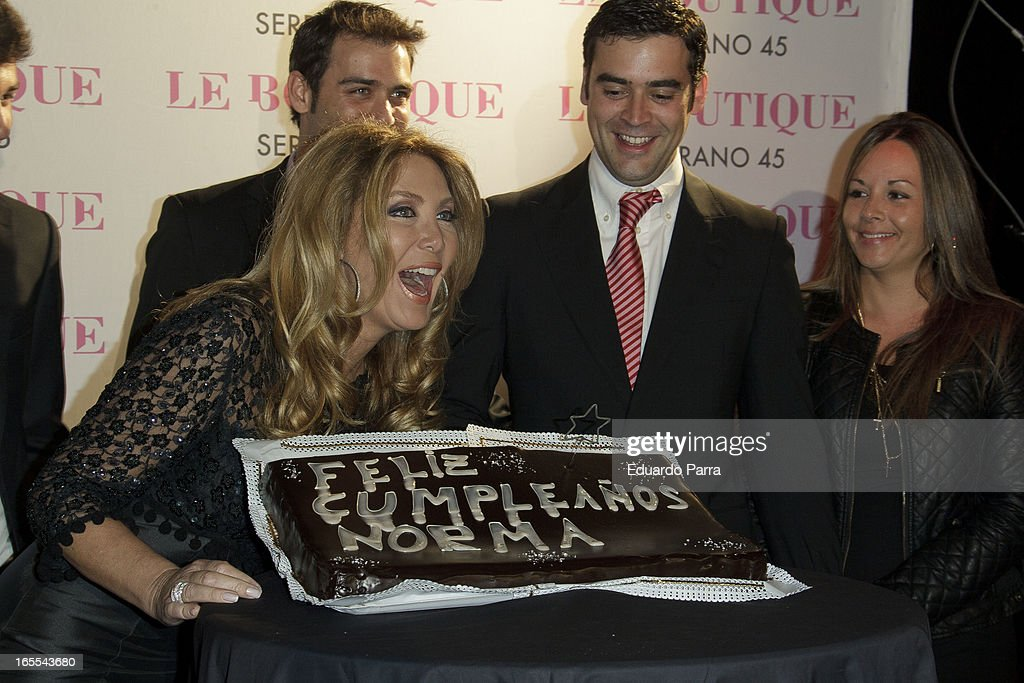 Norma Duval blows out the candles on her birthday cake at the photocall of the birthday party of Norma Duval at Le Boutique disco on April 4, 2013 in Madrid, Spain.