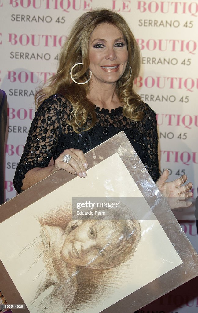 Norma Duval poses with a picture of his sister Carla at the photocall for her birthday party at Le Boutique disco on April 4, 2013 in Madrid, Spain.