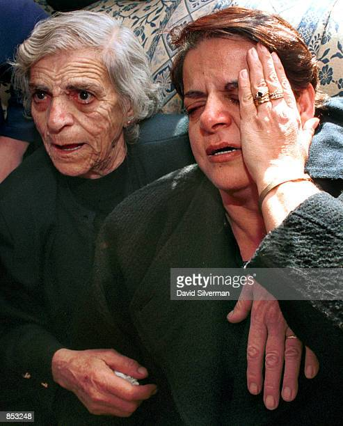 Norma Fischer right Palestinian Christian wife of German doctor Harald Fischer mourns her husband along with her mother November 16 2000 during his...