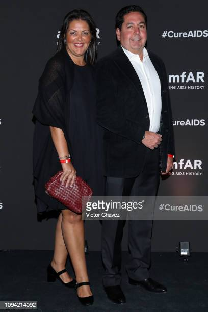 Norma Gonzalez and Gustavo Gonzalez pose during the amfAR gala dinner at the house of collector and museum patron Eugenio López on February 5 2019 in...