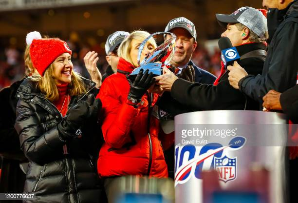 Norma Hunt widow of Chiefs founder Lamar Hunt kisses the AFC Championship trophy named after her late husband during the award ceremony for the...