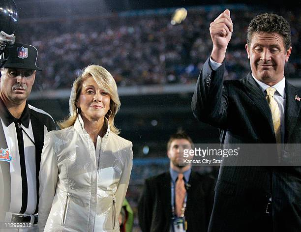 Norma Hunt widow of the late Kansas City Chiefs' owner Lamar Hunt iwatches as Dan Marino performs the coin toss at Super Bowl XLI in Miami Florida on...
