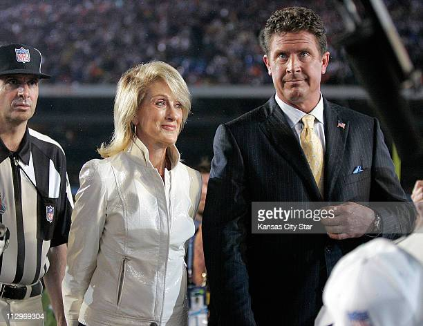 Norma Hunt widow of the late Kansas City Chiefs' owner Lamar Hunt is escorted by Dan Marino for the coin toss at Super Bowl XLI in Miami Florida on...