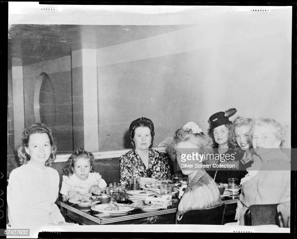 Norma Jeane Baker future film star Marilyn Monroe at a Chinese restaurant with members of her family circa 1942
