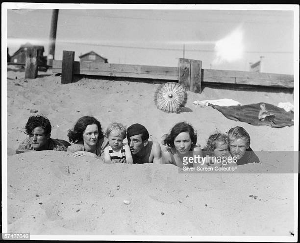 Norma Jeane Baker future film star Marilyn Monroe on the beach as a toddler with her mother Gladys Baker and a group of friends circa 1929