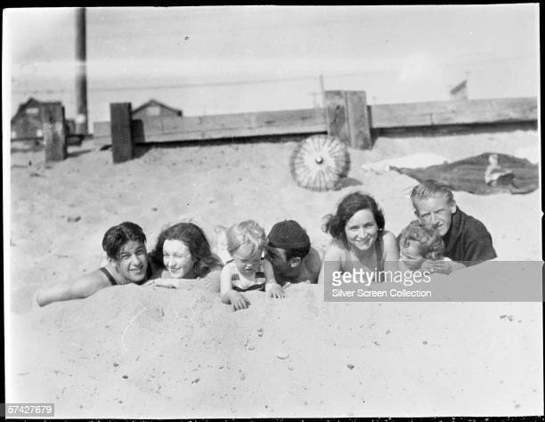 Norma Jeane Baker, future film star Marilyn Monroe , on the beach as a toddler with her mother Gladys Baker and a group of friends, circa 1929.