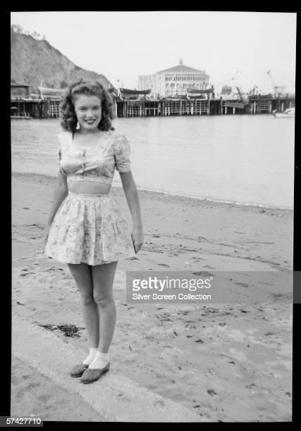 Norma Jeane Baker future film star Marilyn Monroe on the beach at Avalon Santa Catalina Island circa 1943 Her first husband James Dougherty was...
