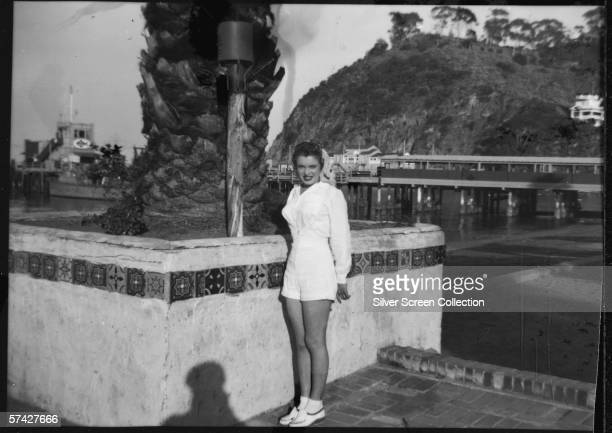 Norma Jeane Baker future film star Marilyn Monroe on the sea front at Avalon Santa Catalina Island circa 1943 Her first husband Jim Dougherty was...