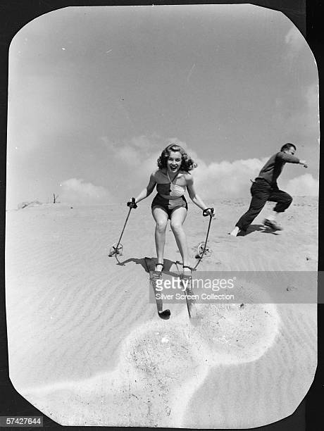 Norma Jeane Baker future film star Marilyn Monroe tries her hand at sand skiing on a dune circa 1943
