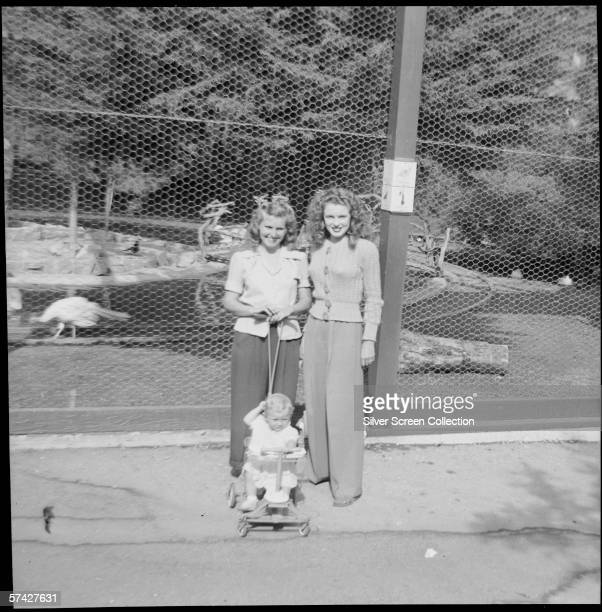 Norma Jeane Baker future film star Marilyn Monroe visits the zoo with a friend and a small child circa 1943