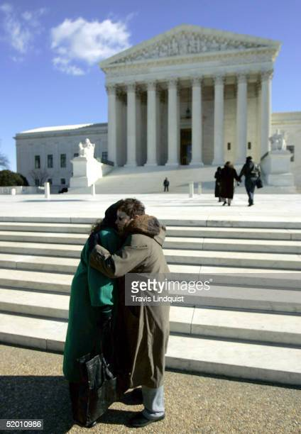 Norma McCorvey the former Roe of Roe vWade hugs an unidentified friend on the steps of the US Supreme Court on January 18 2005 in Washington DC...