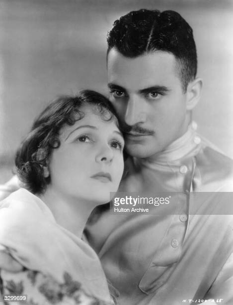 Norma Talmadge the American silent heroine and Gilbert Roland the Mexican leading man in a scene from 'The Woman Disputed' directed by Henry King and...