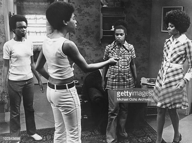 Norma threatens Netta in an angry confrontation as Billie Jean and Ruth Ann watchi in horror in a tense scene from the movie Black Girl which was...