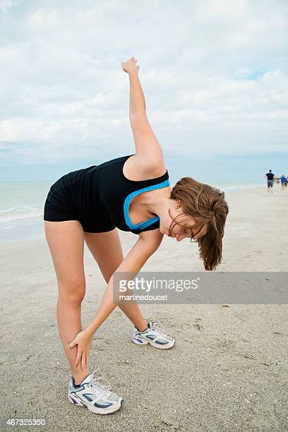 "normal looking young woman exercising on the beach. - ""martine doucet"" or martinedoucet stock pictures, royalty-free photos & images"