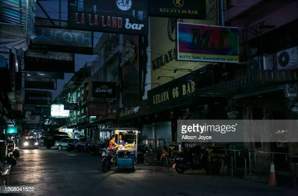A normally busy bar and party street is mostly empty on March 23 2020 in Pattaya Thailand On March 18th Pattaya announced the closure of schools bars...