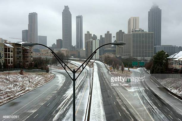 A normally busy Freedom Parkway sits empty in front of the Atlanta skyline on February 12 2014 in Atlanta Georgia Public schools were closed for...