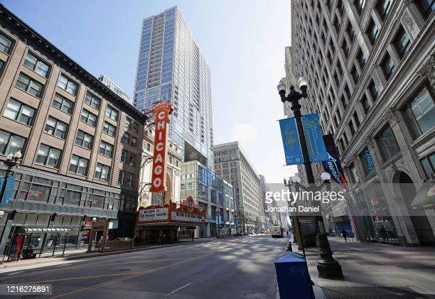 """Normally very busy State street featuring the Chicago Theater is seen during the """"shelter in place"""" order that was continued until April 30 for the..."""