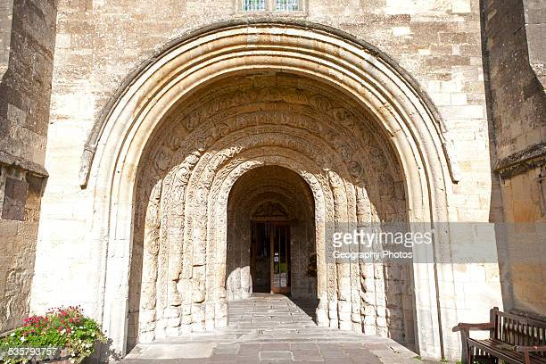 Norman arched door Malmesbury abbey church building Wiltshire England UK