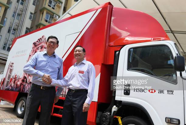 Norman Chan TakLam Chief Executive of the Hong Kong Monetary Authority and Peter Wong Tungshun General Manager of HSBC Group and the CEO of The...