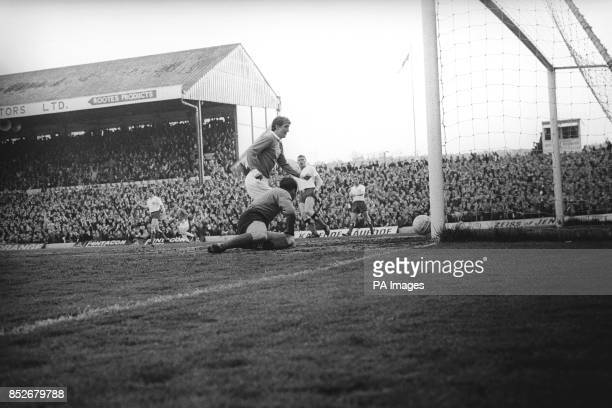 Norman Dean of Cardiff smashes the ball past SV Hamburg goalkeeper Ankos Oezcan to score the first goal for the Welsh team in the second leg of the...