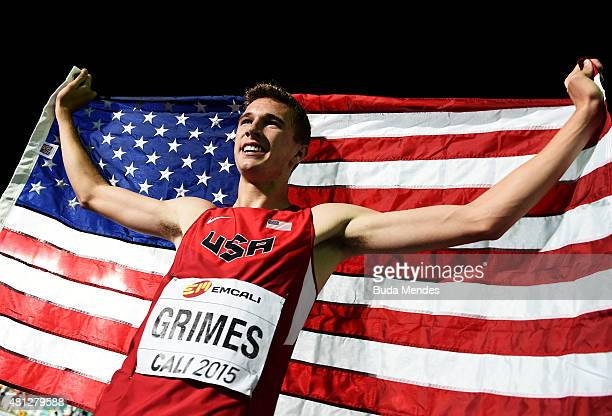 Norman Grimes of the USA celebrates with the American flag after winning the Boys 400 Meters Hurdles Final on day four of the IAAF World Youth...