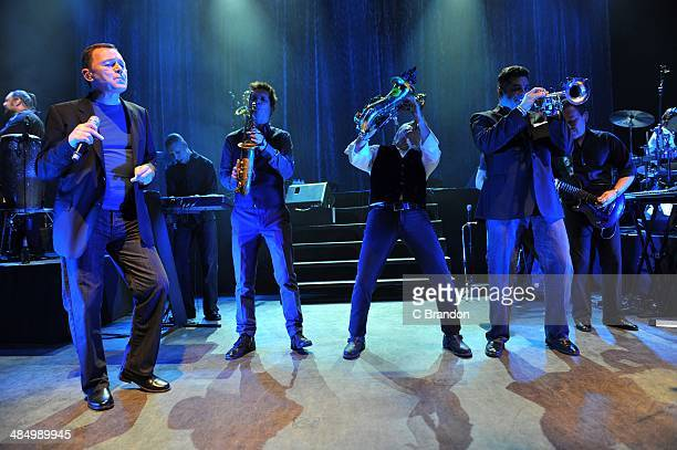 Norman Hassan Duncan Campbell Tony Mullins Martin Meredith Brian Travers Laurence Parry and Robin Campbell of UB40 perform on stage at Shepherds Bush...